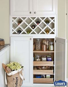 A built-in mini pantry and wine rack make the most of kitchen square footage. This smart storage solution creates a stylish look that's packed with function!