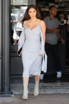 Kim Kardashian out to lunch in LA wearing a light grey Juan Carlos Obando dress with Yeezy sock boots.