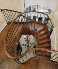Curved staircase looking down from second floor.