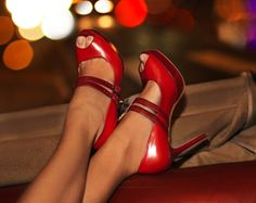 "Beautiful red high heels..love the shoes, except for the spikes.  If I wore them, I would be clicking my heels together saying, ""There's no place like home."""