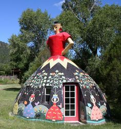 The Dome Lady - Apache Creek, NM;   built by Bev Magennis;  serves as a guest space on a 10-acre property;  the dome is 12 feet in diameter, and 18 feet tall, and the exterior is covered in ceramic tile;  built in the same style as Bev's 'Garden Ladies' sculptures