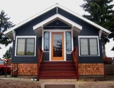 dark gray house with natural wood trim outdoor - Google Search