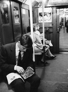 Chess champion Bobby Fischer working on his moves during a subway ride. 1962. (via LIFE)