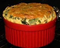 Spinach Soufflé Recipe- I added 4 cloves of garlic and half an onion. 1/4 tsp of nutmeg and pepper. Also reduced the parmesan cheese and butter.