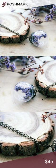 """""""Romantic Resplendence""""🌼Lavender Flower Necklace Your everyday reveries are about to get a fashionable update with the addition of this glass terrarium necklace to your accessories collection! Inspiring an imaginative state of mind with tiny lavender flowers, dried to perfection, and encased in a glass bulb, while its ornate gold top and hangs delicately by an antique gold chain- This blithsome piece, permits you to receive all the praise your sweet styling deserves. ;) 🌼Handcrafted with…"""