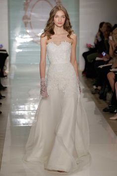 Love how Reem Acra accessorises this streamlined lace gown with beaded sheer gloves. Bridal fashion week spring 2015