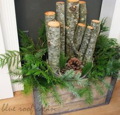"""Natural front porch decor idea using """"vintage"""" crate, logs, greenery and pinecones... add branch lights for a little shine!"""