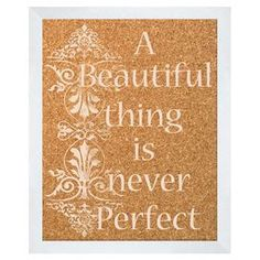 """Framed corkboard with a silk-screened typographic motif and scrolling garland accent.  Product: CorkboardConstruction Material: Cork and polystyreneColor: WhiteFeatures:  Silkscreen imageReady to hang Dimensions: 22"""" H x 18"""" W"""