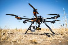camera copter. Depending on what sort of camera you want to mount, it starts at around £2,000 and goes up to £5,000  http://www.camtraptions.com/copters/