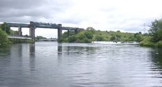 Irlam railway viaduct and Mersey Weir on the Manchester Ship Canal