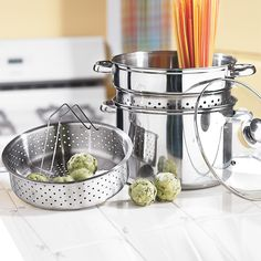 """This 4-In-1 Pot cooks virtually everything! Stainless steel 8-Qt. Stock Pot makes soups, stews, chili and more. Includes a steamer basket to cook quick-n-easy, healthy-n-delicious veggies, plus a pasta basket to cook-n-drain noodles, ravioli and such!   tempered glass lid with steam vent lets you observe the cooking process  dishwasher safe 4-pc. set measures: 12¾""""H x 10""""Diam.  shop our entire selection of durable cookware at BrylaneHome, as well as dinnerware and ..."""