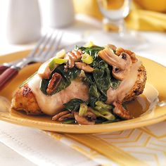 Spinach and Mushroom Smothered  Chicken Recipe -Chicken breasts stay nice and moist tucked under a blanket of melted cheese. It's extra special to serve but is not tricky to make. —Katrina Wagner, Grain Valley, Missouri