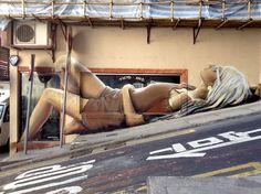 "Streetart: ""Reclinning Lady""-Mural by Artist Victoriano in Hong Kong"