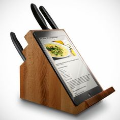 Adding a tiny ledge to the back side of a standard wooden knife block turns it into something significantly more useful.