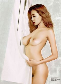 Topless beauty covering her nipples with a rope
