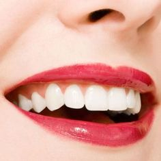 Makeup Tip: Get whiter teeth by using a red or berry lip color. Blue based red and berry lip colors contrast with yellowness in teeth making teeth appear whiter.