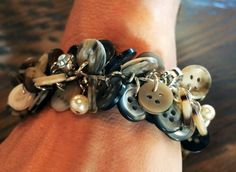 """Found on Facebook: """"My friend Cindy's dad recently passed away. One of her cousins took all the buttons off Cindy's dad's shirts and made button charm bracelets for Cindy and her mom. All she did was attach each button with jump rings to a bracelet on both sides of the link and embellished it with crystals, pearls and charms. I think this is such a sweet idea and looks """"cute as a button."""""""""""