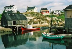 Peggy's Cove, Nova Scotia. One of the coolest places. a tiny town built on solid rock. I wondered about plumbing...