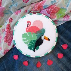A summery pink flamingo cross stitch pattern, featuring a flamingo, a toucan and some palm leaves. If you're looking for a bird cross stitch chart or cross stitch birds, this one's ideal as a flamingo DIY gift. With a Hawaii theme style, this is an easy bird pattern chart and makes