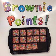A cute idea for student rewards, a baking sheet and a picture of brownies with magnets pasted on the back. Each time the students earn a square of a brownie for good behavior, when the pan is complete you bring in brownie treats :)