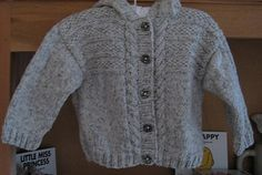 Pattern for a hooded jacket or a round necked jumper, buttoned at shoulder.