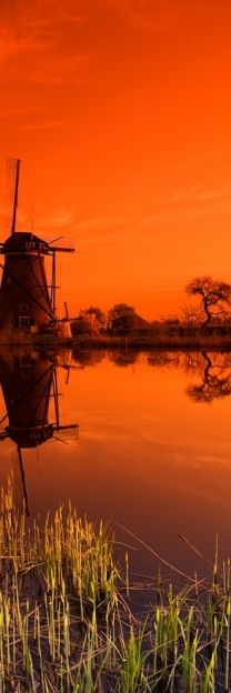 Beautiful sunset cast its orange glow over a dutch windmill on the river in Holland! Lonly Planet, South Holland, Holland Netherlands, Foto Art, Le Moulin, Belle Photo, Silhouettes, Wonders Of The World, Cool Photos