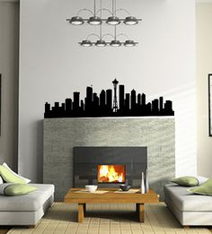 Well, this is a fun one! Seattle Skyline Wall Decal. I really like the idea of going over a fireplace too! Definitely a fun skyline!   www.tradingphrases.com