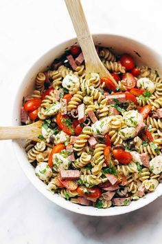 Best Easy Italian Pasta Salad - with pasta, tomatoes, fresh mozzarella, spicy salami, parsley, olives, and easy Italian dressing. Super versatile to what you have on hand! Sponsored by @DeLalloFoods | pinchofyum.com