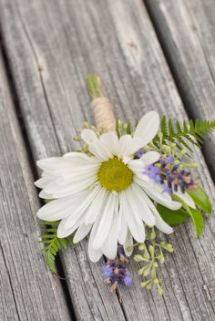 wedding boutonniere with white daisy, green and purple seeded eucalyptus and ferns wrapped with twine | photo: jarrudaphotography.com | floral design: fawnmeadowdesign.com