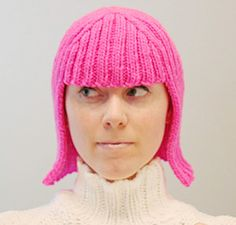 by Megan Reardon.   I found myself wondering just what I could do with all that cheap, bright acrylic yarn one finds in craft shops. I also found myself thinking about Halloween. This wig is worked from the bottom up, the bound off edge is the center part.