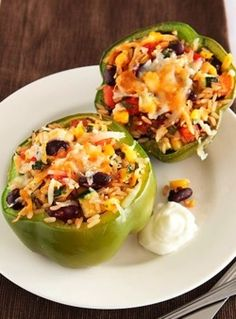 Mexican Poblano Stuffed Peppers INGREDIENTS: • 1 cup cooked red beans, drained and rinsed • 1 cup cooked long-grain brown rice • 1/2 cup frozen whole kernel corn, thawed • 1 medium tomato, diced • 1...