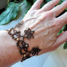 """New bracelet which I developed from a vintage edging pattern. In this I've used size 20 Lizbeth thread in the color """"Fudge Dark"""", siz..."""