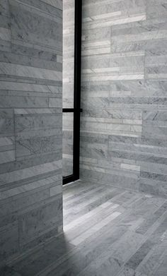 again showing effects achievable through rough wood formwork and modern glass