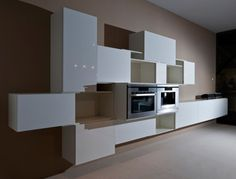 'Repeat' kitchen system by Danilo Radice and Elam for a modern kitchen- Presented as a multifunctional modular storage system for any room of the house, these cupboards, shelves and drawers fit comfortably in the modern kitchen and, with lacquer and wood finishes to mix and match, sit particularly prettily in an open plan space where cooking and living areas blend.