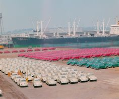 1965 Port of Portland, Huge shipment of Volkswagen Beetles parked by color.