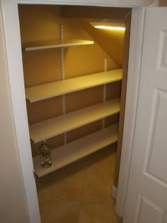 Handyman Extraordinaire: New shelving in a small nook under stairs