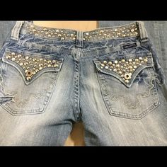 "Miss Me Jeans With Rhinestones.  Sz 29  Check out these Miss Me jeans with Rhinestones..  Sz 29   Waist 15"" inseam 26.5  rise 8"". These pants have been professionally hemmed. Miss Me Jeans Boot Cut"