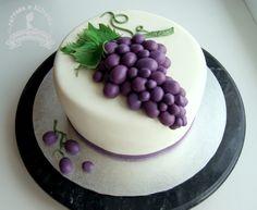 Grapes, small cake with fondant grapes. Fruit cake.
