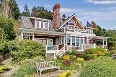 Waterfront Craftsman Home for sale in Bainbridge Island, Washington Waterfront Craftsman home in Bainbridge Island, WA. Architect's own home. Windows and craftsman woodwork glory. Kitchen island bookcase, bump out look-out. Craftsman Style Homes, Craftsman Bungalows, Storybook Homes, Bainbridge Island, Cottage Living, Coastal Cottage, Coastal Living, Waterfront Homes, My Dream Home