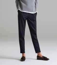 Burgundy loafers are a nice contrast instead of an expected black shoe. Everlane.