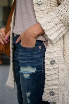 Ripped jeans, knit cardigan