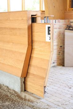 Sliding gate for an indoor arena. This is a little too fancy, but I love the idea of a track door. So much easier while mounted I imagine. ~I honestly think this is great~ Barn Stalls, Horse Stalls, Dream Stables, Dream Barn, Horse Barn Plans, Horse Arena, Indoor Arena, Sliding Gate, Farm Barn