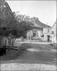 1908 ~ Ploutarchou street in Kolonaki, Athens. Lycabettus Hill in the background Athens History, Greece History, Old Pictures, Old Photos, Vintage Photos, Athens City, Athens Greece, Greece Photography, Adventure Is Out There