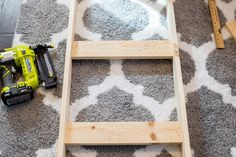 DIY Blanket Ladder for less than $5 a great tutorial and an easy project to add a great piece of organizational decor to your home.