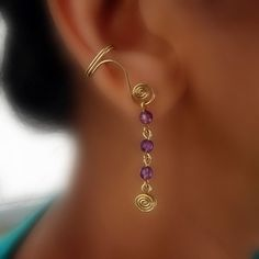 I am LOVING these ear cuffs! I wear quite a bit of purple, too, so these would be wonderful. Now, if only they came in silver...