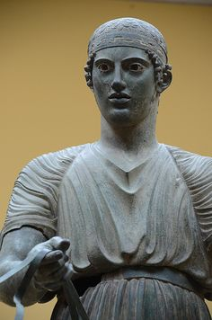 """Such a beautiful statue. He stands in Delphi museum in Greece. The """"charioteer"""" is a life size statue in bronze that was cast about 475 B.C. It was discovered in 1896 near the Temple of Apollo. Usually bronze statues such as this were melted down and recycled after they had outlived their usefulness/interest. But his statue had fallen off its pedestal and was crushed during the earthquake of 373 B.C.—and thus has been preserved almost intact."""