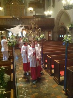 Trying acolytes and finishing final touches on flowers