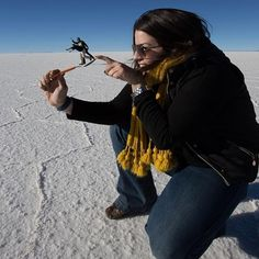 The vast salt flats of Salar de Uyuni, Bolivia offer the perfect backdrop for photographs that fool the eye.