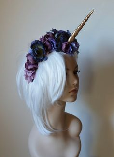Instantly transform into your inner unicorn with this handmade unicorn horn and floral headband. Padded with felt and lace underneath and secured with an elastic strap that sits behind the head. Please indicate the color, or color combo, you want the flowers to be, then choose your horn color.  To find out more about my life, art and work, visit me on:  my website - http://www.serpentfeathers.com/  Instagram - https://www.instagram.com/kaamorastreya  Patreon - ht...