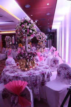 Wedding and Sangeet Decor - Vintage English Table Centrepiece with Floral Table Linen, Pastel Decor | WedMeGood #wedmegood #decor #DIY #indianwedding #weddingdecor #sangeet